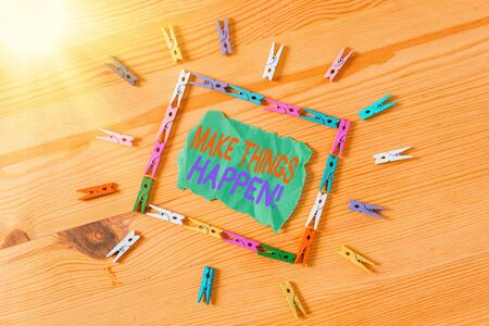 Conceptual hand writing showing Make Things Happen. Concept meaning you will have to make hard efforts in order to achieve it Colored crumpled papers wooden floor background clothespin