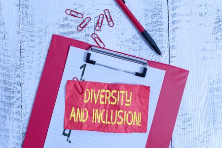 Text sign showing Diversity And Inclusion. Business photo showcasing range difference includes race ethnicity gender Clipboard paper sheet clips ballpoint crushed note old vintage background Archivio Fotografico