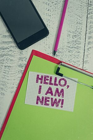 Word writing text Hello I Am New. Business photo showcasing introducing oneself in a group as fresh worker or student Clipboard sheet pencil smartphone squared sticky note wooden background