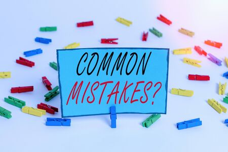 Word writing text Common Mistakes question. Business photo showcasing repeat act or judgement misguided or wrong Colored clothespin papers empty reminder white floor background office 版權商用圖片
