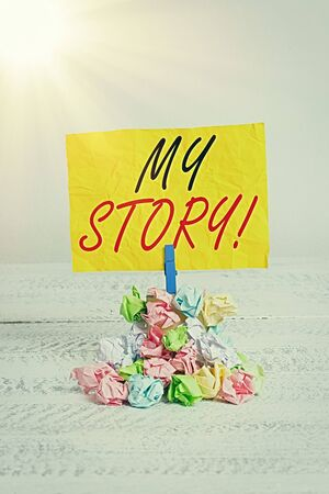 Word writing text My Story. Business photo showcasing the things or situations that have happened to someone in life Reminder pile colored crumpled paper clothespin reminder white wooden space