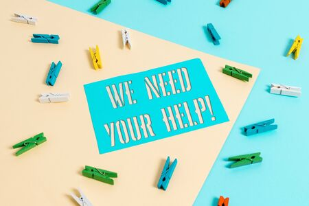 Writing note showing We Need Your Help. Business concept for asking someone to stand with you against difficulty Colored clothespin paper reminder with yellow blue background