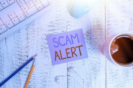 Text sign showing Scam Alert. Business photo showcasing unsolicited email that claims the prospect of a bargain technological devices colored reminder paper office supplies keyboard mouse