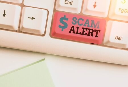 Writing note showing Scam Alert. Business concept for unsolicited email that claims the prospect of a bargain 版權商用圖片