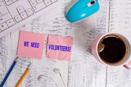 Handwriting text We Need Volunteers. Conceptual photo someone who does work without being paid for it technological devices colored reminder paper office supplies keyboard mouse