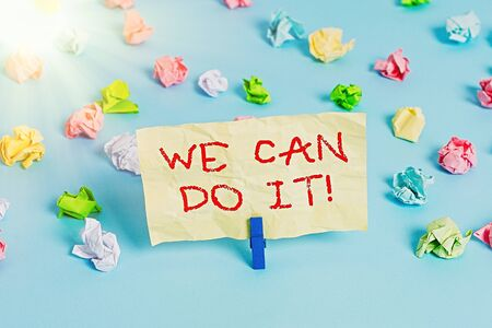 Word writing text We Can Do It. Business photo showcasing see yourself as powerful capable demonstrating Colored crumpled papers empty reminder blue floor background clothespin