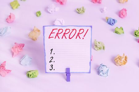 Conceptual hand writing showing Error. Concept meaning state or condition of being wrong in conduct judgement or program Colored crumpled paper empty reminder white floor clothespin 版權商用圖片