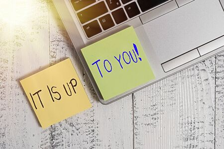 Text sign showing It Is Up To You. Business photo showcasing Used to tell a demonstrating that they are the one to decide Trendy silver metallic laptop two sticky note pads lying vintage table Stock Photo
