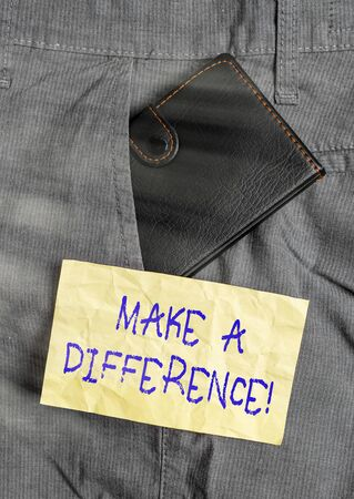 Word writing text Make A Difference. Business photo showcasing have significant effect or non on demonstrating or situation Small little wallet inside man trousers front pocket near notation paper