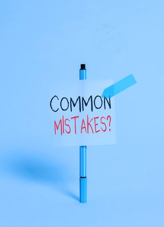 Conceptual hand writing showing Common Mistakes question. Concept meaning repeat act or judgement misguided or wrong Ballpoint sticky note arrow banner peaceful cool background Stock Photo