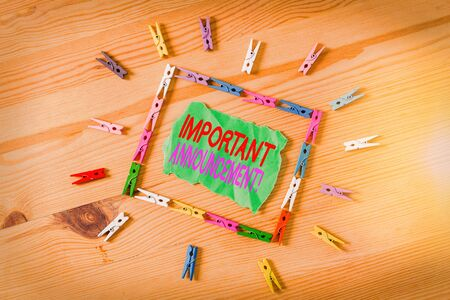 Conceptual hand writing showing Important Announcement. Concept meaning spoken statement that tells showing about something Colored crumpled papers wooden floor background clothespin 版權商用圖片
