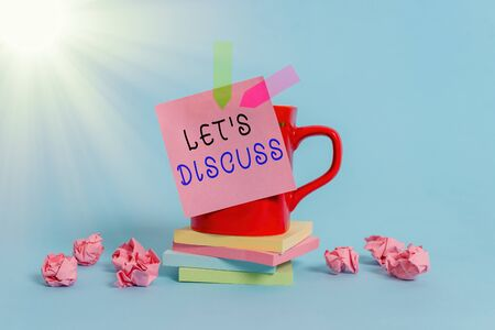 Conceptual hand writing showing Lets Discuss. Concept meaning asking someone to talk about something with demonstrating or showing Coffee cup sticky note banners paper balls pastel background