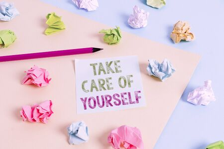 Text sign showing Take Care Of Yourself. Business photo showcasing a polite way of ending a gettogether or conversation Colored crumpled papers empty reminder blue yellow background clothespin