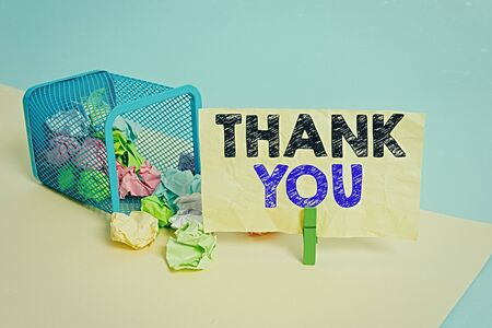 Word writing text Thank You. Business photo showcasing a polite expression used when acknowledging a gift or service Trash bin crumpled paper clothespin empty reminder office supplies tipped