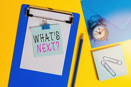 Word writing text Whats Next Question. Business photo showcasing asking demonstrating about his coming actions or behaviors Clipboard sheet note binder pencil clips clock envelop colored background Standard-Bild