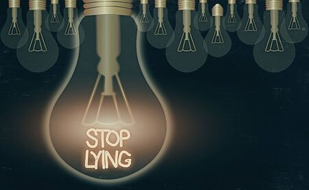 Text sign showing Stop Lying. Business photo text put an end on chronic behavior of compulsive or habitual lying Stock Photo