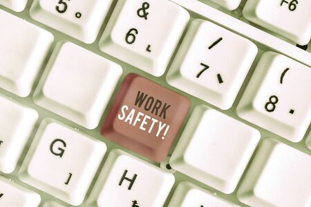 Writing note showing Work Safety. Business concept for policies and procedures in place to ensure health of employees