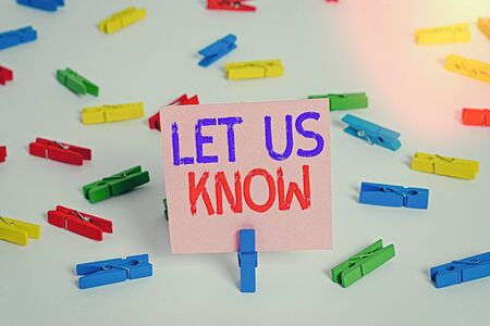 Writing note showing Let Us Know. Business concept for to make or allow an individual impression of honest interest Colored clothespin papers empty reminder white floor background office