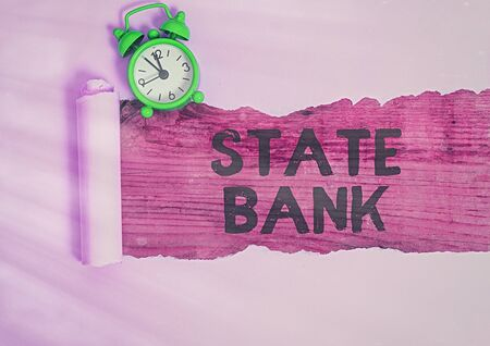 Conceptual hand writing showing State Bank. Concept meaning generally a financial institution that is chartered by a state.