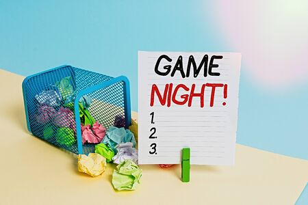 Conceptual hand writing showing Game Night. Concept meaning usually its called on adult play dates like poker with friends Trash bin crumpled paper clothespin reminder office supplies