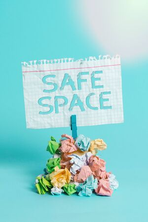 Word writing text Safe Space. Business photo showcasing a place or room in which you are protected from harm or danger Reminder pile colored crumpled paper clothespin reminder blue background Banco de Imagens