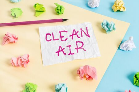 Text sign showing Clean Air. Business photo showcasing air that has no harmful levels of dirt and chemicals in it Colored crumpled papers empty reminder blue yellow background clothespin