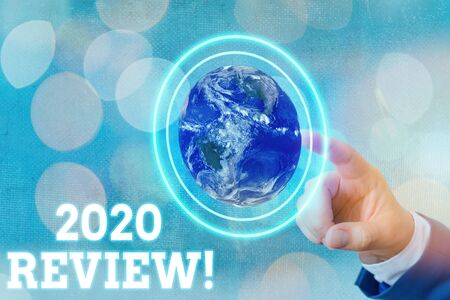 Writing note showing 2020 Review. Business concept for remembering past year events main actions or good shows Standard-Bild