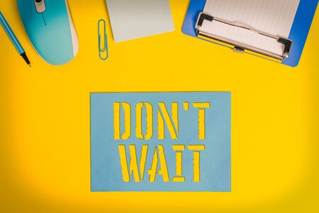 Conceptual hand writing showing Don T Wait. Concept meaning Take action now and do something for a purpose Act quickly Clipboard paper sheet mouse pencil note colored background