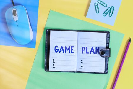 Writing note showing Game Plan. Business concept for strategy worked out in advance in sport politics or business Locked diary striped sheets marker notepad mouse colored background