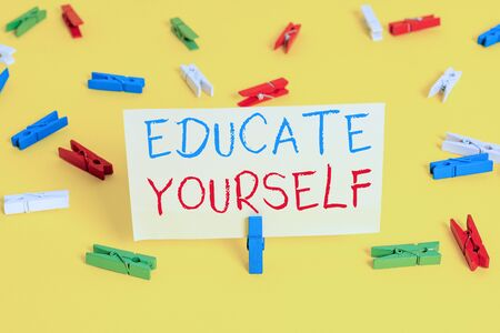 Word writing text Educate Yourself. Business photo showcasing prepare oneself or someone in a particular area or subject Colored clothespin papers empty reminder yellow floor background office