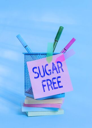 Text sign showing Sugar Free. Business photo text containing an artificial sweetening substance instead of sugar Sticky note arrow banners stacked pads metal pens holder pastel background