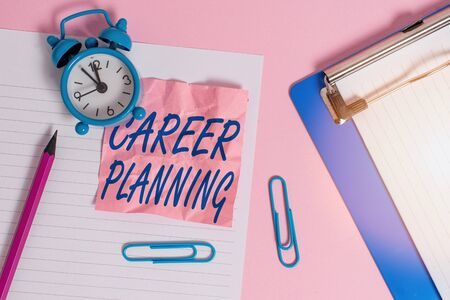 Text sign showing Career Planning. Business photo text Strategically plan your career goals and work success Paper sheet note clipboard pencil clips alarm clock colored background Stock fotó