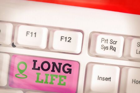 Writing note showing Long Life. Business concept for able to continue working for longer than others of the same kind