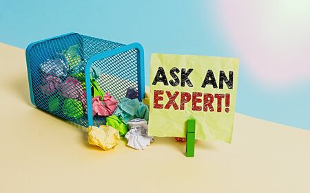 Writing note showing Ask An Expert. Business concept for consult someone who has skill about something or knowledgeable Trash bin crumpled paper clothespin reminder office supplies