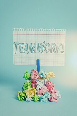 Writing note showing Teamwork. Business concept for combined action of group especially when effective and efficient Reminder pile colored crumpled paper clothespin wooden space