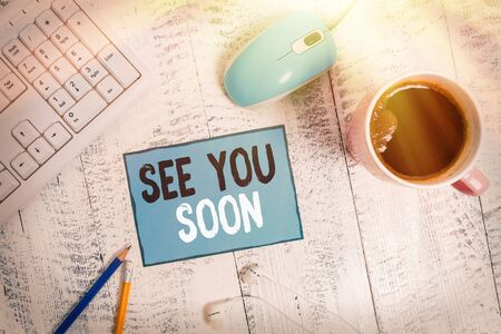 Text sign showing See You Soon. Business photo text used for saying goodbye to someone and going to meet again soon technological devices colored reminder paper office supplies keyboard mouse