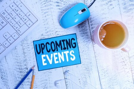 Text sign showing Upcoming Events. Business photo text the approaching planned public or social occasions technological devices colored reminder paper office supplies keyboard mouse 版權商用圖片