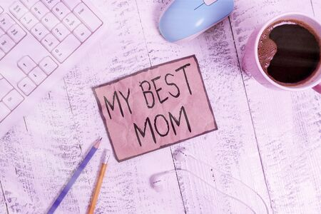Writing note showing My Best Mom. Business concept for Appreciation for your mother s is love feelings compliment Technological devices colored reminder paper office supplies