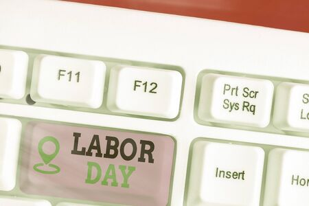 Writing note showing Labor Day. Business concept for an annual holiday to celebrate the achievements of workers
