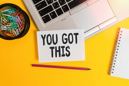 Writing note showing You Got This. Business concept for to encourage someone to succeed in dealing with something Laptop pencil squared paper sheet container spiral colored background