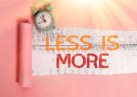 Writing note showing Less Is More. Business concept for used to express a minimalist approach is more effective.