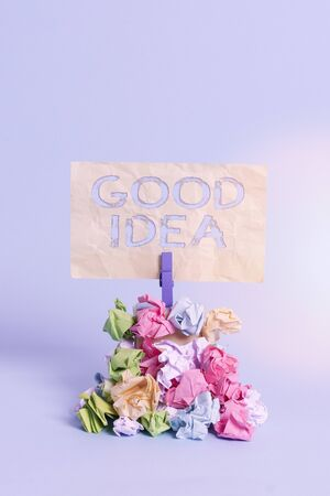 Handwriting text writing Good Idea. Conceptual photo an excellent suggestion and plan for achieving something Reminder pile colored crumpled paper clothespin reminder blue background 스톡 콘텐츠