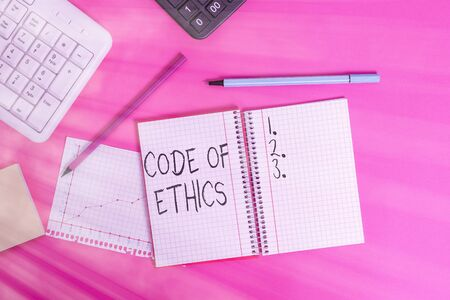 Text sign showing Code Of Ethics. Business photo text basic guide for professional conduct and imposes duties Writing equipments and computer stuffs placed above classic wooden table