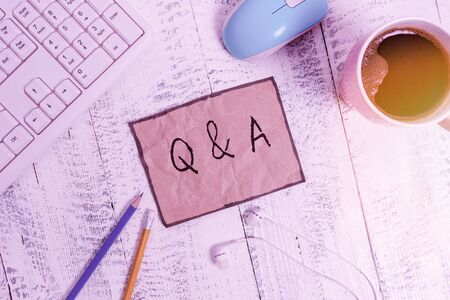 Writing note showing Q And A. Business concept for a period of time or an occasion when someone answers questions Technological devices colored reminder paper office supplies