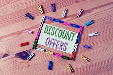 Word writing text Discount Offers. Business photo showcasing amount or percentage deducted from the normal selling price Colored clothespin papers empty reminder wooden floor background office