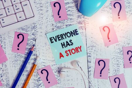 Conceptual hand writing showing Everyone Has A Story. Concept meaning Background storytelling telling your memories tales Writing tools and scribbled paper on top of the wooden table