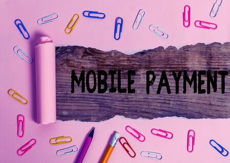 Text sign showing Mobile Payment. Business photo showcasing the payment made through a portable electronic device Stationary and torn cardboard placed above a wooden classic table backdrop