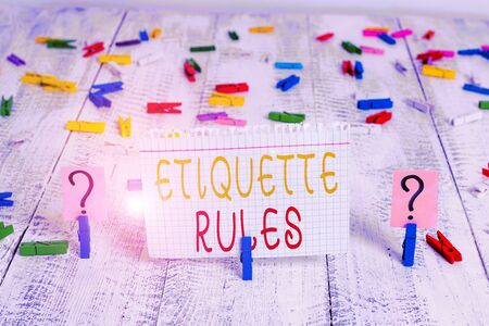 Word writing text Etiquette Rules. Business photo showcasing customs that control accepted behaviour in social groups Scribbled and crumbling sheet with paper clips placed on the wooden table Banque d'images