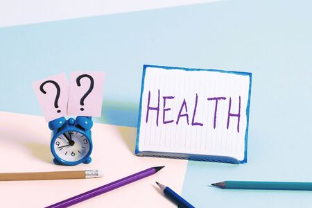 Word writing text Health. Business photo showcasing condition of the body and the degree to which it is free from illness Mini size alarm clock beside stationary placed tilted on pastel backdrop