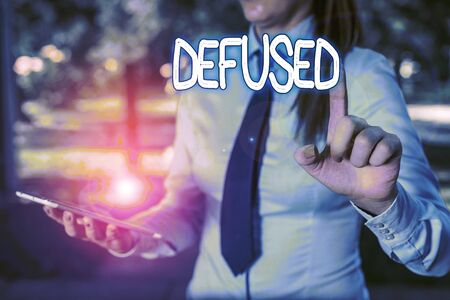 Word writing text Defused. Business photo showcasing make a difficult or dangerous situation calmer by reducing its cause Handsome business girl pointing with finger into empty space
